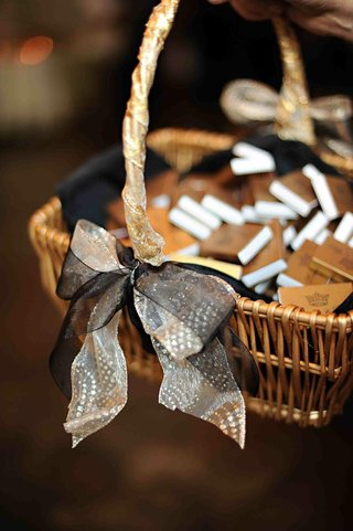 gold-matchboxes-in-ribbon-embellished-basket