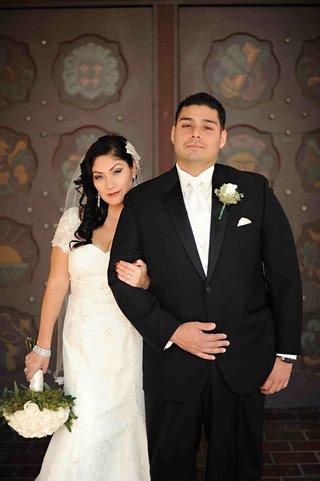 lace-sleeved-wedding-dress-and-white-vest-tuxedo