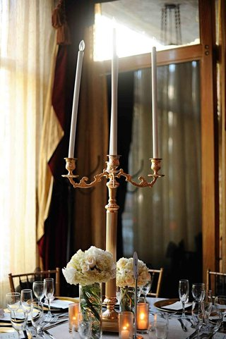 small-floral-arrangements-next-to-candelabra