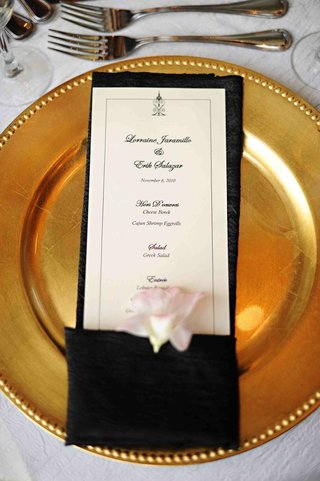 black-and-white-menu-card-in-napkin-on-gold-plate