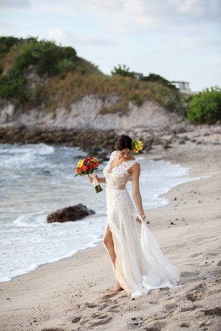 bride-fixing-ines-di-santo-gown-beach-punta-mita-mexico-colorful-headpiece-bouquet-shoot-morning