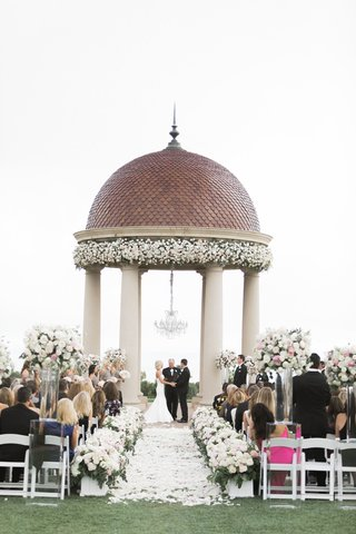 wedding-ceremony-resort-at-pelican-hill-chandelier-white-pink-flowers-greenery