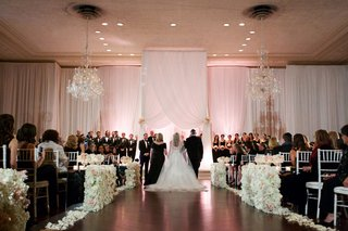 bride-walking-down-ballroom-wedding-ceremony-aisle-with-mom-and-dad-jewish-wedding-tradition