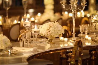 wedding-reception-at-the-mar-a-lago-club-white-rose-centerpiece-floating-candle-and-candelabra