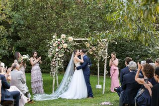 wedding-ceremony-green-lawn-birch-four-post-ceremony-structure-pink-greenery-white-flowers