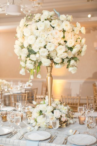 tall-gold-centerpiece-with-white-roses-cascading-tulips-and-gold-leaves-at-base-dallas-wedding