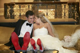 couple-wearing-christian-louboutin-shoes-kissing
