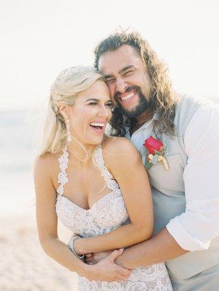 bride-in-halter-neck-olia-zavozina-wedding-dress-and-groom-in-white-shirt-tan-vest-rose-boutonniere