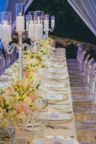 banquet-tabes-with-patterned-linens-crystal-candelabra-with-pillar-candles-white-and-pink-florals