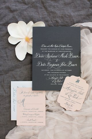 wedding-invitation-grey-cardstock-with-white-calligraphy-and-reply-cards-in-millennial-pink