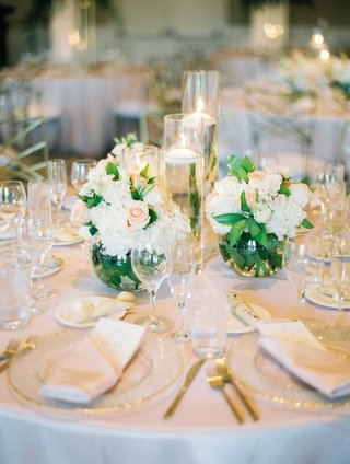 wedding-reception-centerpiece-small-round-vases-white-hydrangea-pink-flower-rose-floating-candles