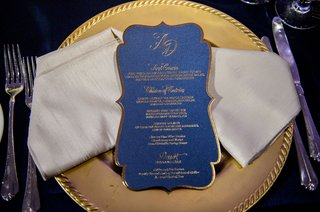 wedding-reception-gold-charger-plate-napkin-and-navy-blue-menu-card-die-cut-gold-border-calligraphy