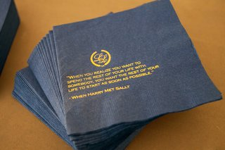 navy-blue-cocktail-napkin-with-gold-printed-monogram-and-love-quote-from-movie