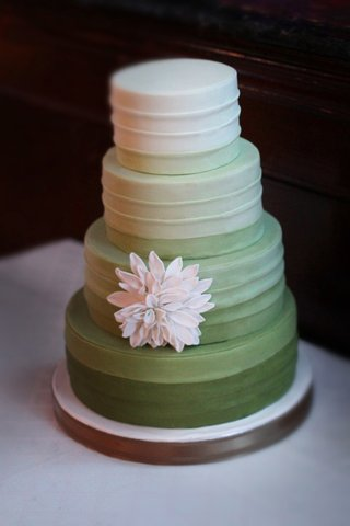 four-layer-wedding-cake-with-green-fading-to-white-color-and-sugar-flower-dahlia-at-wedding
