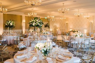 wedding-reception-ballroom-belmond-el-encanto-chandeliers-tall-centerpiece-peach-pink-white-gold
