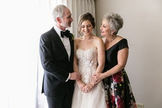 sweet-moment-with-bride-in-mira-zwillinger-wedding-dress-mother-in-black-and-flower-print-gown