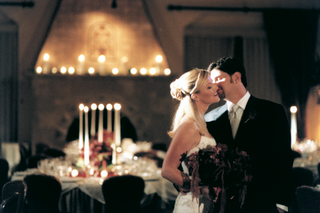 bride-and-groom-kiss-in-reception-ballroom