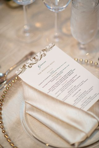 menu-card-on-top-of-silky-napkin-and-gilt-rimmed-charger