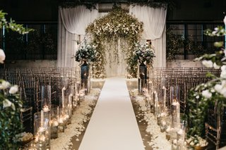 former-miss-america-savvy-shields-pretty-white-and-greenery-wedding-ceremony-altar-drapery-flowers