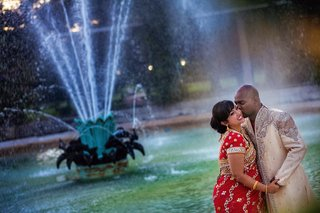 indian-couple-kissing-by-a-new-orleans-fountain