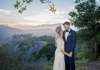 bohemian-bride-and-groom-couple-gaze-at-each-other-on-hilltop-in-santa-barbara