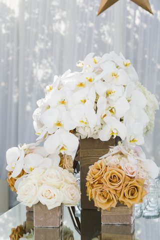 square-boxes-filled-with-white-and-gold-flowers