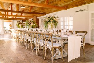 long-wooden-tablescape-motif-faux-wedding-party-styled-shoot-rustic-event-white-runner-green-florals
