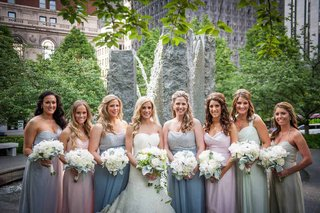 bride-in-a-strapless-lace-isabelle-armstrong-dress-with-bridesmaids-in-pastel-amsale-and-jim-hjelm