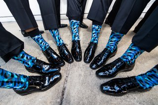 groom-and-groomsmen-with-crazy-patterned-blue-socks