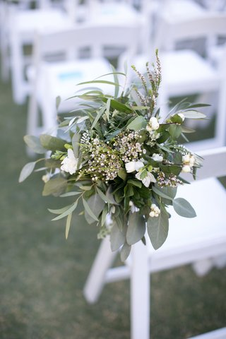 ceremony-chair-decoration-with-leaves-and-small-white-flowers