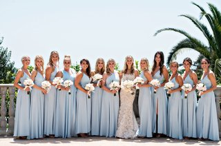 bride-in-ines-di-santo-wedding-dress-with-bridesmaids-in-light-blue-gowns-white-bouquets-bel-air-bay