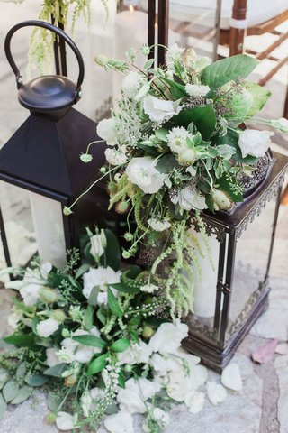 black-lanterns-at-front-of-ceremony-with-white-flowers-and-greenery