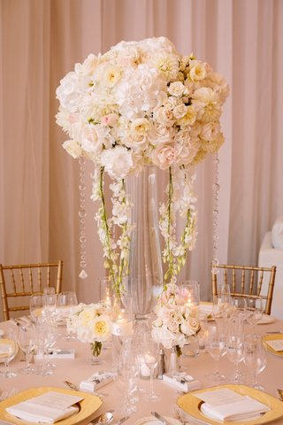 tall-flurry-centerpiece-of-ivory-blossoms-with-cascading-crystals-and-orchids