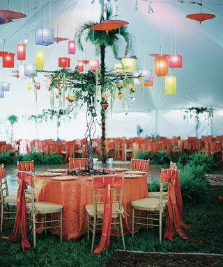reception-tent-with-colorful-tablecloths-and-lanterns