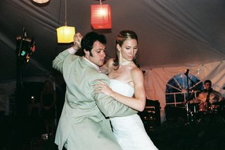 bride-and-groom-on-dancing-in-reception-tent