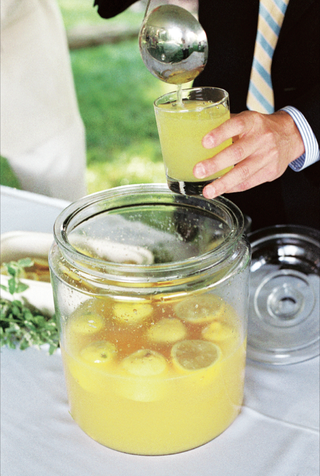 big-jar-filled-with-lemon-halves-and-yellow-drink