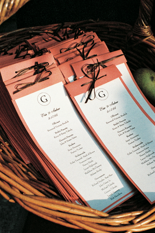 coral-wedding-programs-tied-with-brown-ribbon