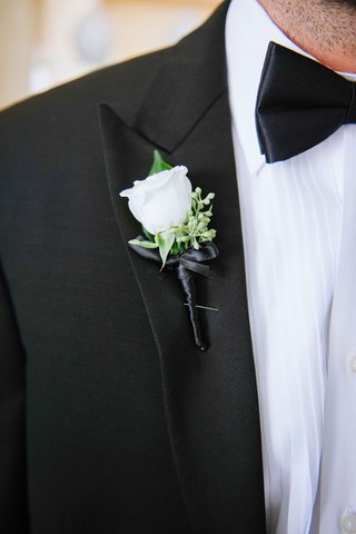 groom-in-black-tuxedo-bow-tie-ivory-rose-boutonniere-on-right-lapel