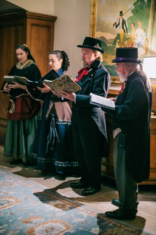 winter-wedding-entertainment-ideas-christmas-carolers-in-traditional-garb-holiday-wedding-theme