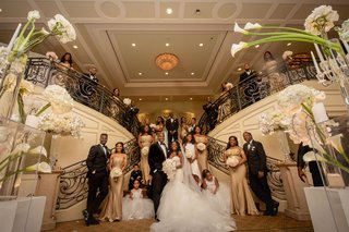 wedding-party-portrait-by-grand-staircase-white-hydrangea-calla-lily-gold-bridesmaid-dresses-tuxedos