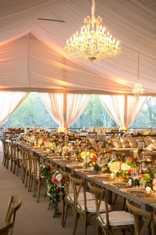blush-tent-wedding-with-chandeliers-and-rustic-wood-tables-with-low-centerpieces