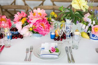 rehearsal-dinner-inspiration-rehearsal-dinner-table-decorated-with-flowers-and-fruit