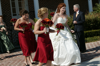 bride-in-white-ball-gown-with-bridesmaids-in-short-red-dresses