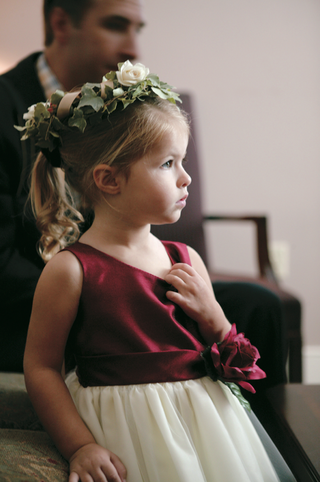 flower-girl-with-green-and-white-flower-crown-and-burgundy-dress