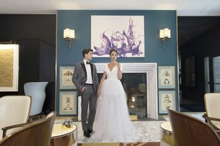 inspirational-wedding-groom-in-grey-tuxedo-bride-in-monique-lhuillier-v-neck-gown-tulle-overskirt