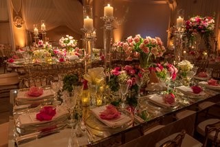 rectangular-wedding-table-with-crystal-candleholders-pink-flowers-in-mirror-boxes-and-vases-pink