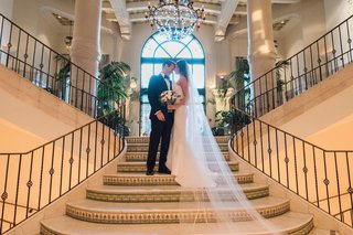 bride-and-groom-touching-forehead-on-the-stairs-of-casa-del-mar