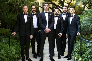 groom-and-groomsmen-in-tuxedos-with-burgundy-calla-lily-boutonniere-styles-bow-ties-hotel-bel-air