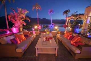outdoor-lounge-area-with-vibrant-lights-and-pillows