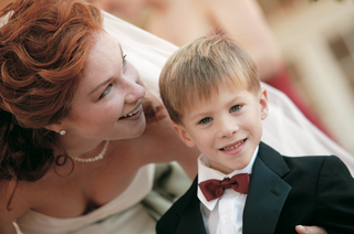 bride-with-ring-bearer-in-tux-and-red-bow-tie